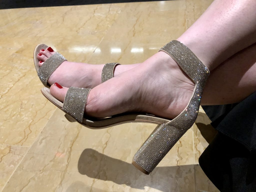 Over 50 Feeling 40 finds high heels at Marine Ball