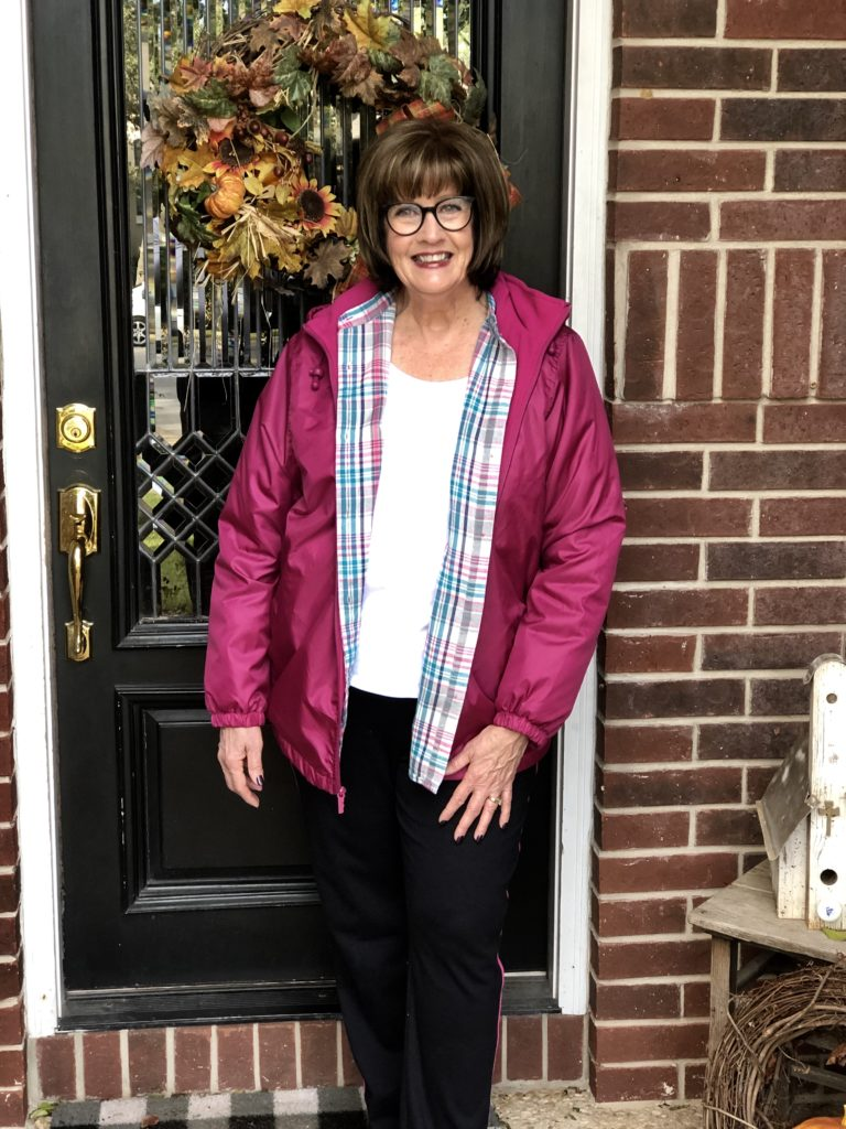 Pamela Lutrell in a pink Totes Jacket
