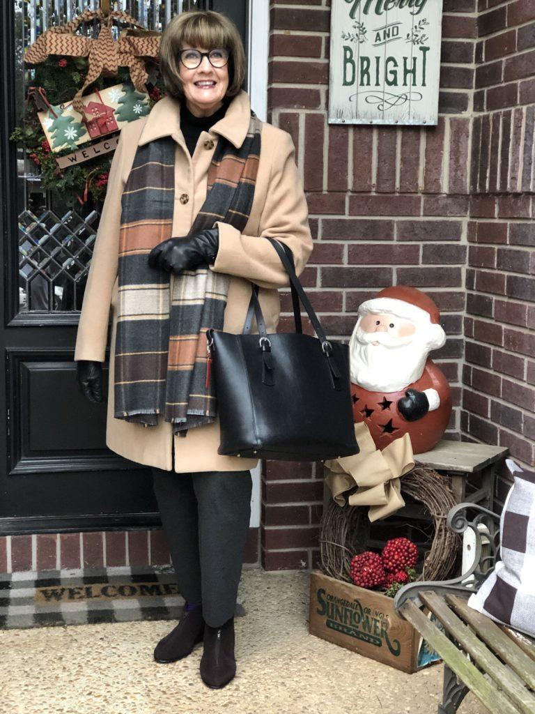 Pamela Lutrell in classic camel coat