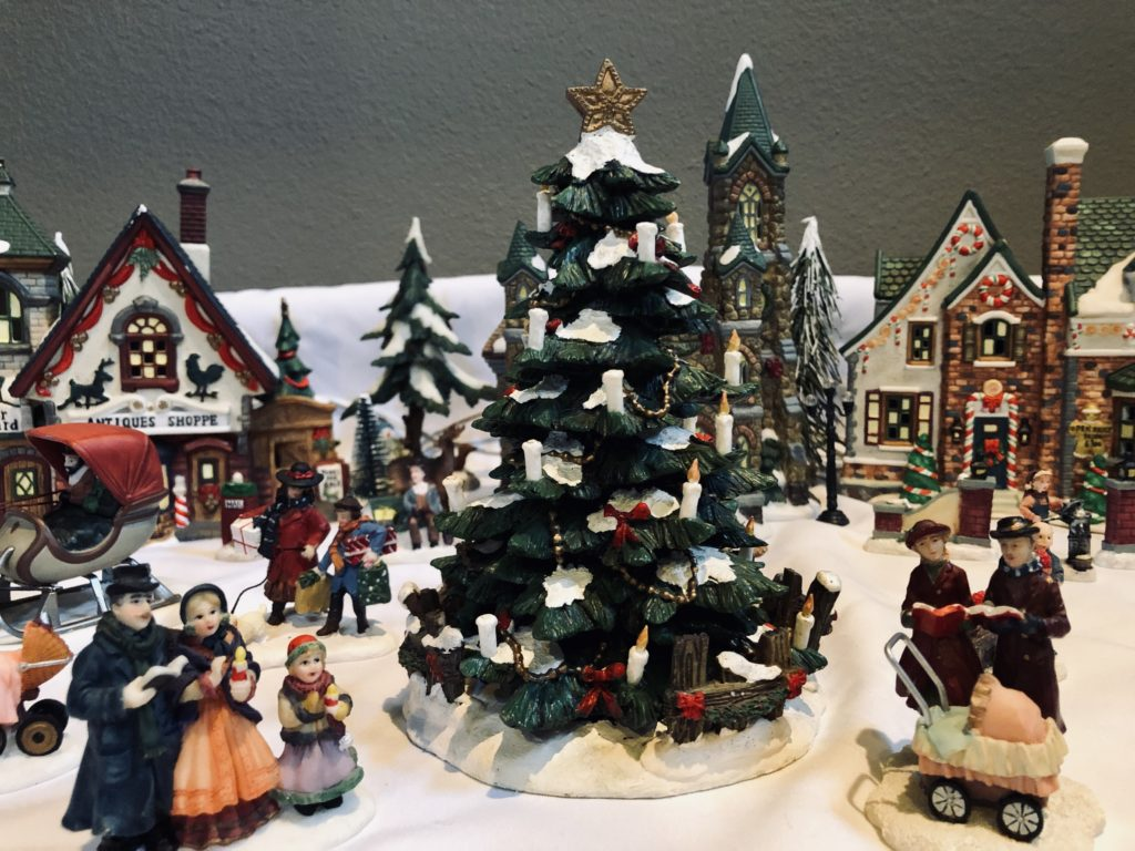 Pamela Lutrell shows her Christmas village