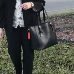 Pamela Lutrell carries leather tote to work