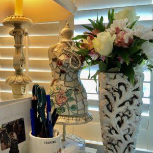 Flowers on desk of Pamela Lutrell