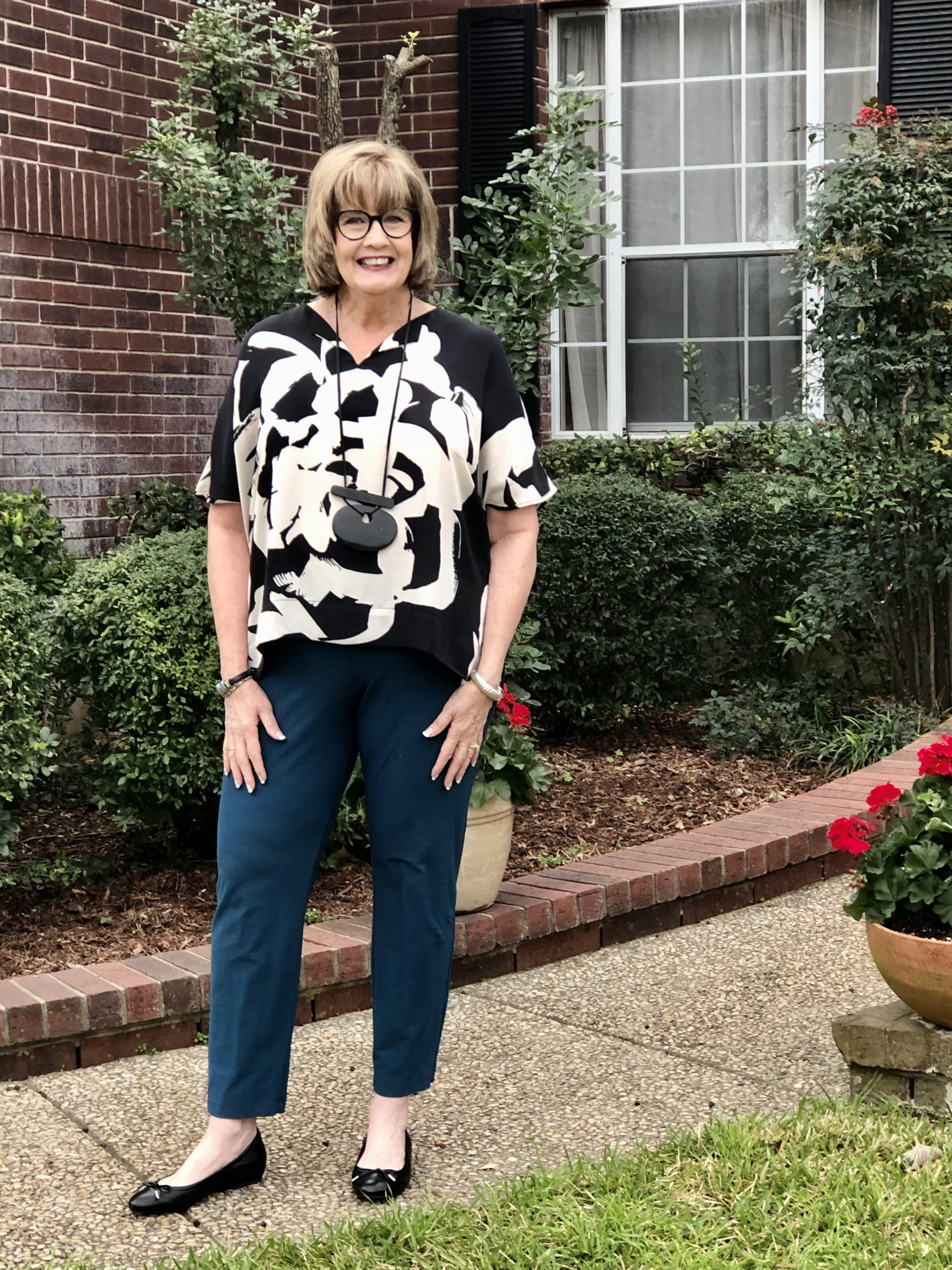 Pamela Lutrell in black & white artistic top from Chicos