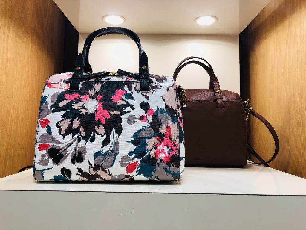Pamela Lutrell with printed handbags for spring at Dillards