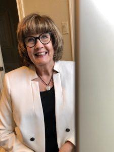 Pamela Lutrell in White House Black Market jacket for video chats