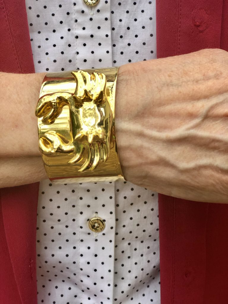 Pamela Lutrell in gold cuff with a crab