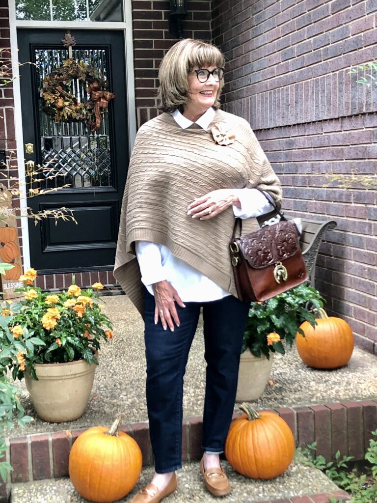 Pamela Lutrell wears cable knit poncho from Goodwill San Antonio