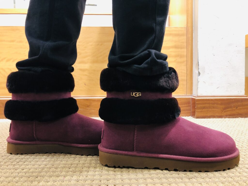 Pamela Lutrell in The Fluff Mini Belted boots by UGG at Dillards
