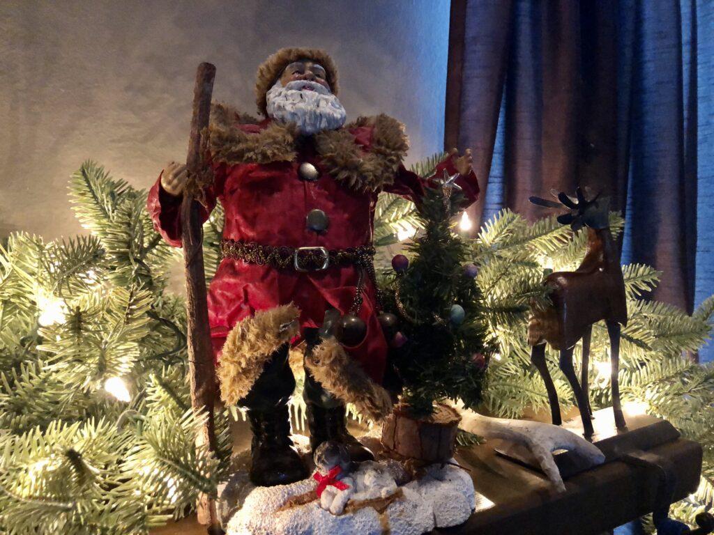 Vintage Santa on the mantel on over 50 feeling 40