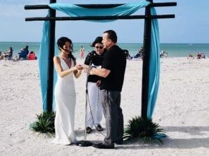 In elegant white denim, Iris officiates a wedding on over 50 feeling 40