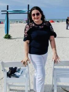 Iris on Over 50 Feeling 40 in elegant casual chic white denim style