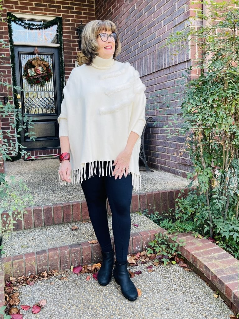Pamela Lutrell in winter white poncho